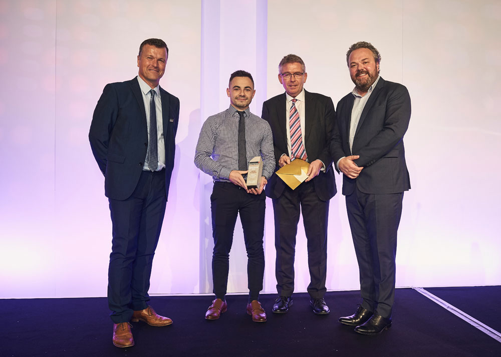 Invisible Connections' Managing Director, Derek Brown, presents the 'Young Achiever' award to Macauley Stock, Southern Concrete